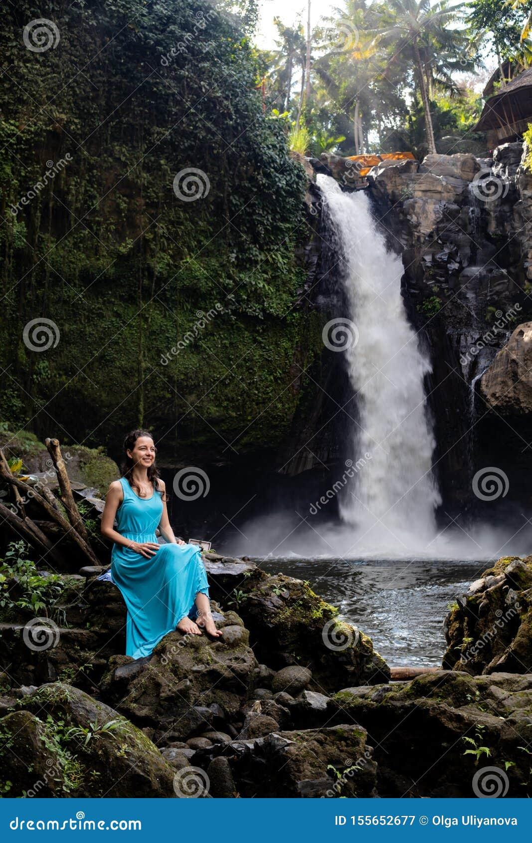 Alone Girl Sitting Beside Waterfall - Instamoz Photo sharing