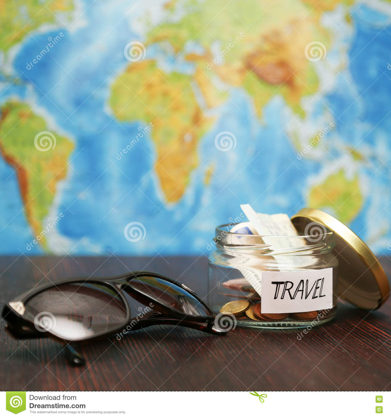 Travel money in jar sunglasses world map at background stock royalty free stock photo gumiabroncs Images