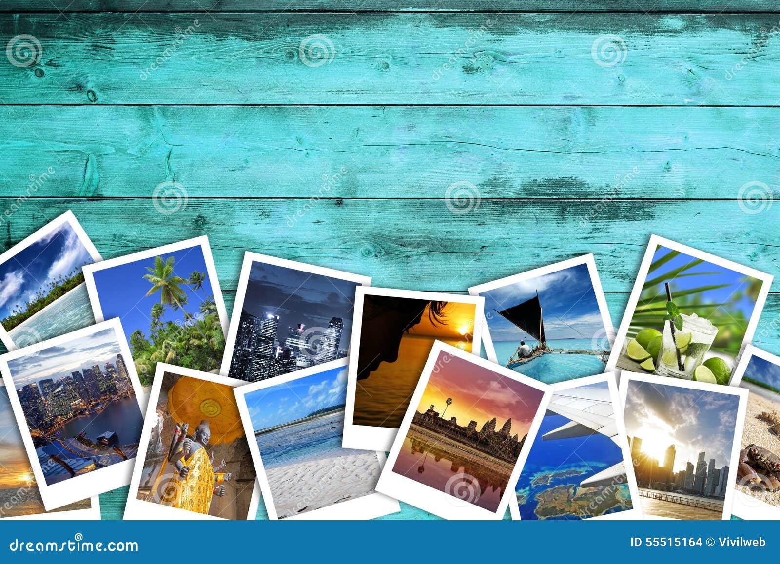 Travel photos on turquoise wood background