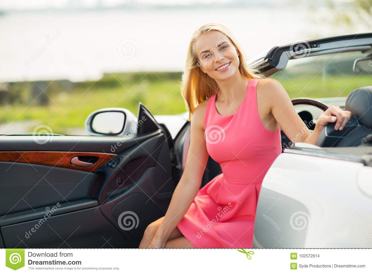 908bc5445 Happy Young Woman Porisng In Convertible Car Stock Photo - Image of ...