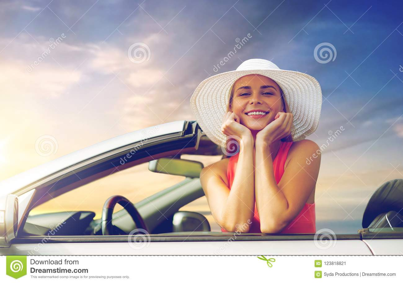 Happy Young Woman In Convertible Car Over Sky Stock Image - Image of ... 8f609769993