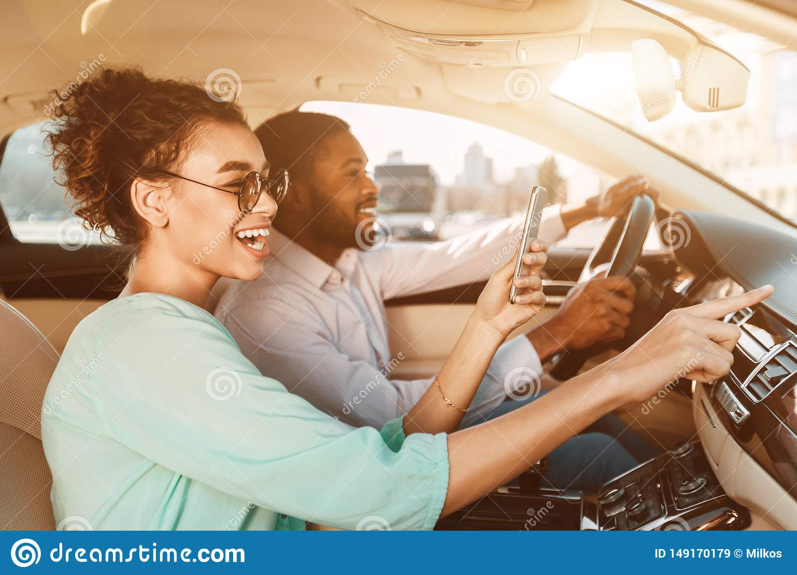 African-American Couple Using Navigator System, Driving Car