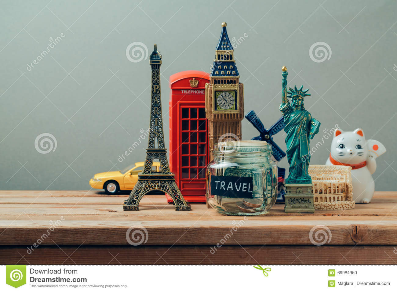 Travel and tourism concept with souvenirs from around the world. Planning summer vacation, money budget trip concept. Saving money