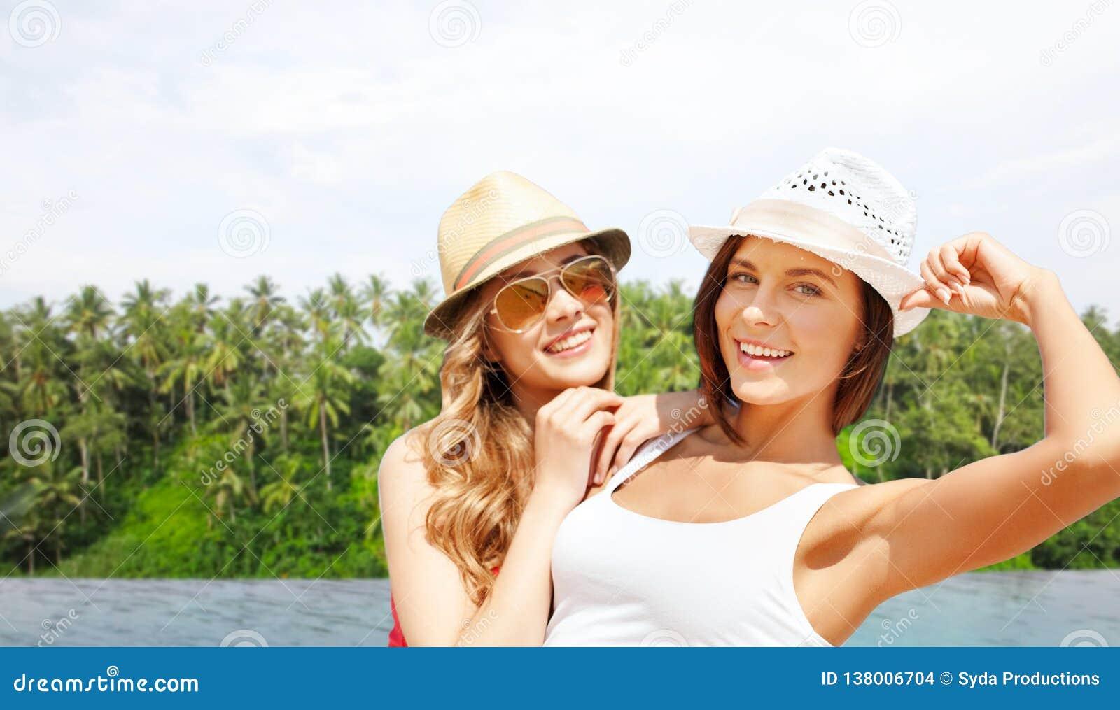 Teenage girls over infinity edge pool in sri lanka
