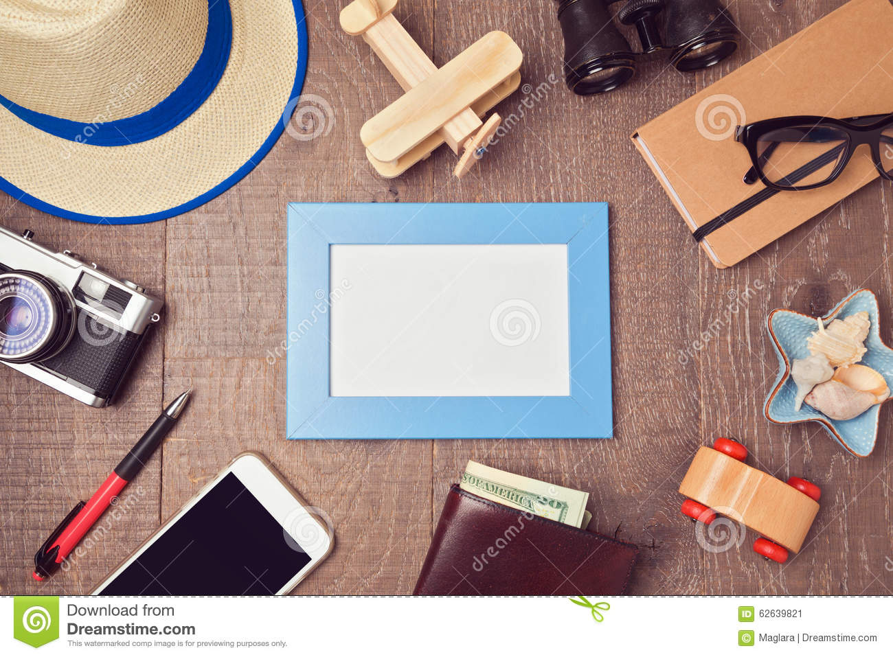 Travel and vacation concept background with blank frame and objects. View from above
