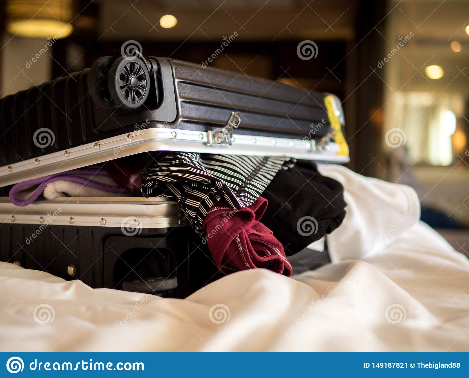 Travel and vacation concept, Packing a lot of clothes and stuff into suitcase on bed prepare for travel and journey trip in