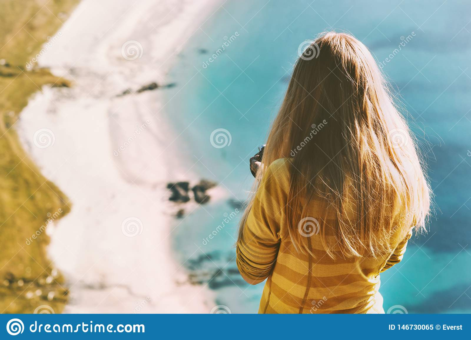 Travel vacations woman tourist standing above ocean