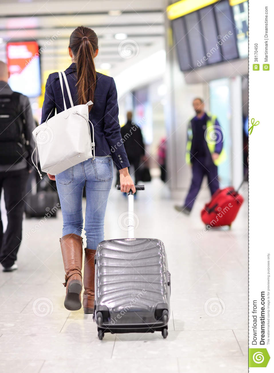 Travel Woman Walking In An Airport With Luggage Stock