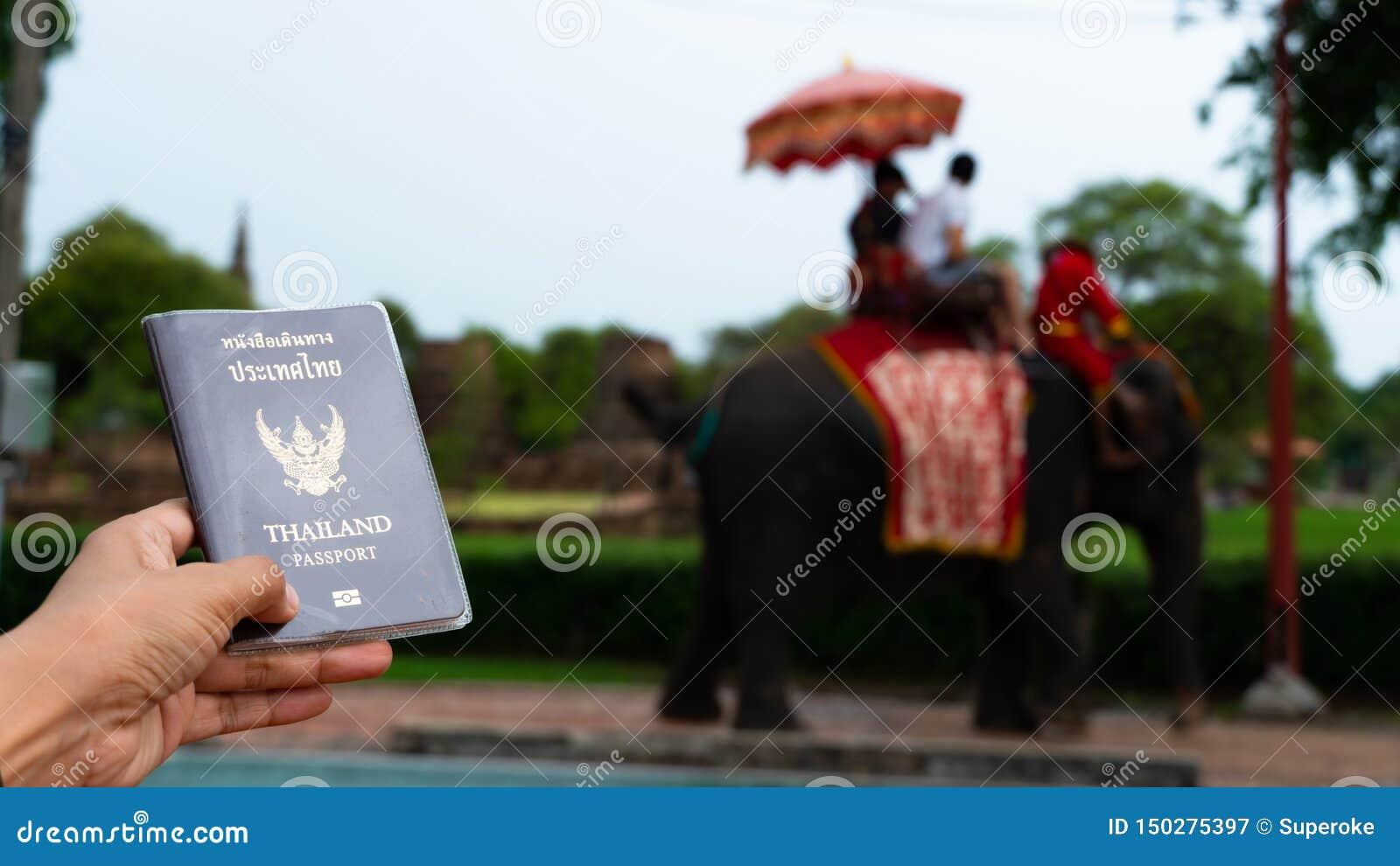 Traveler holding Thailand passport in Ayutthaya Thailand