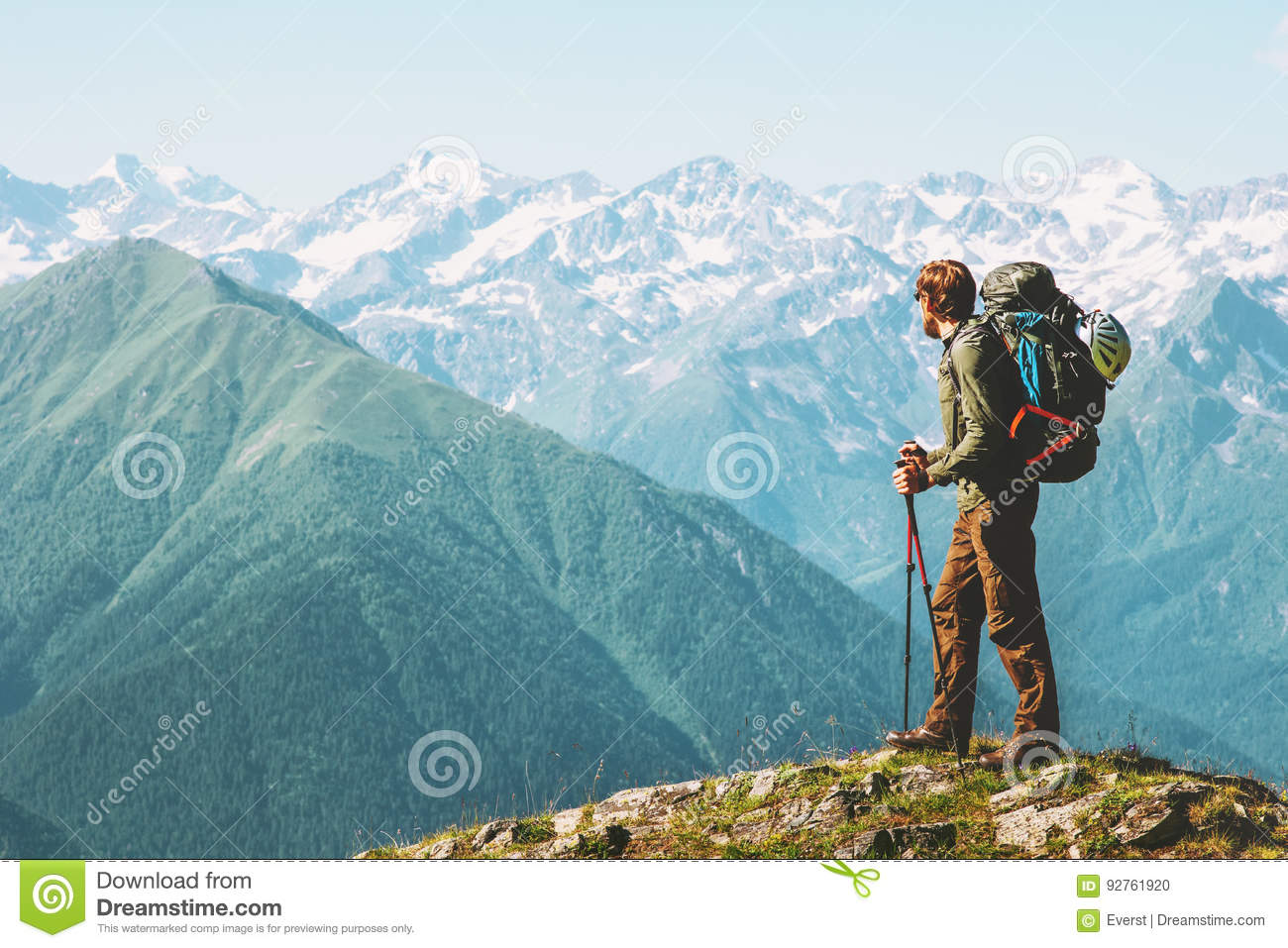 3df1a0154f7b Traveler Man hiking with backpack Travel Lifestyle concept adventure summer  vacations outdoor Caucasus mountains range landscape on background