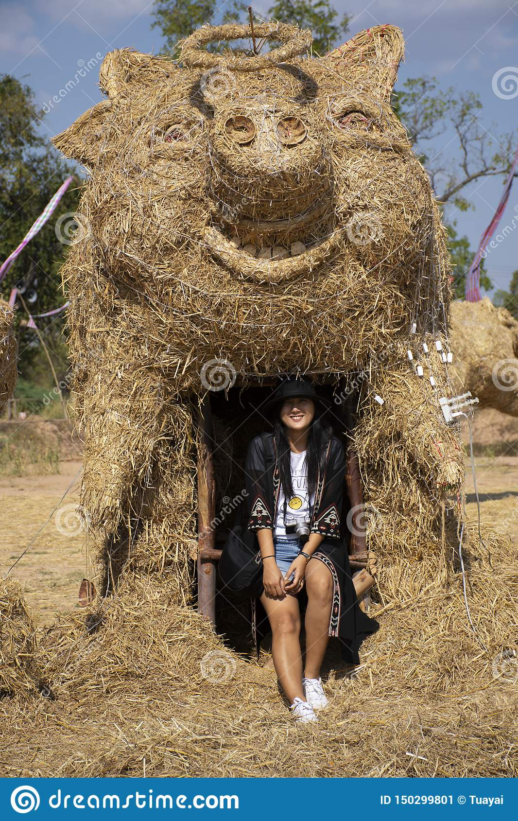 Travelers thai women people travel visit and posing portrait for take photo straw puppets or straws man figure Festiva
