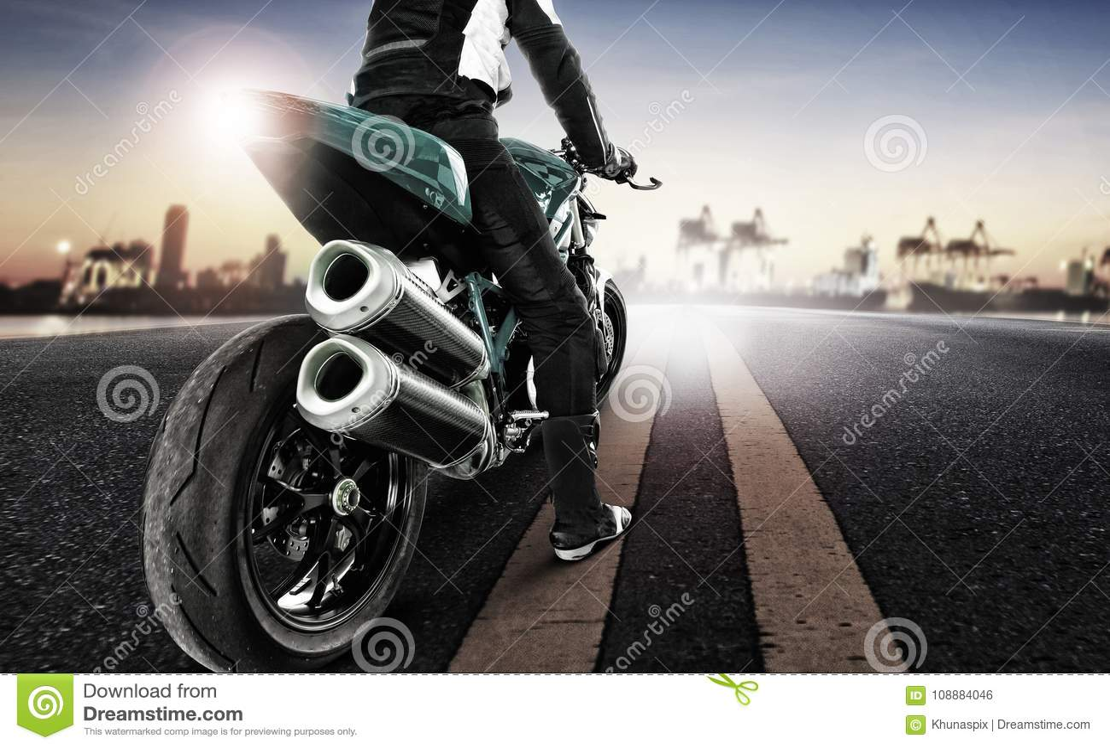 Traveling man riding big motorcycle on urban road