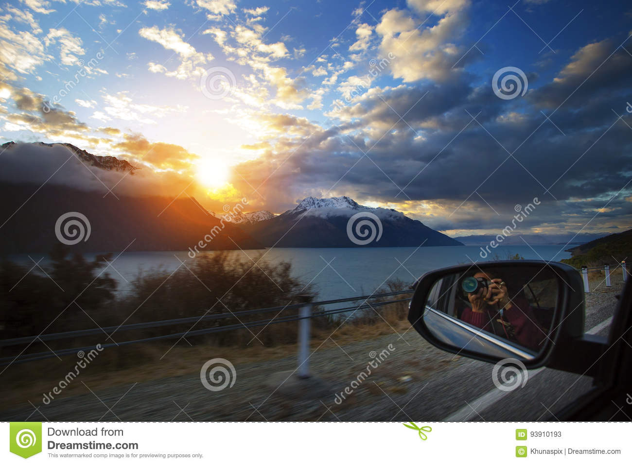 Traveling Man Taking Sunset Photography While Car Driving On Country Road Beside Lake Wakatipu South Island New Zealand Stock Image Image Of Detective Road 93910193