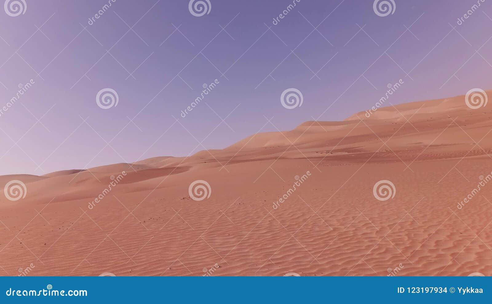 traveling on an off road car on the sand of rub al khali desert
