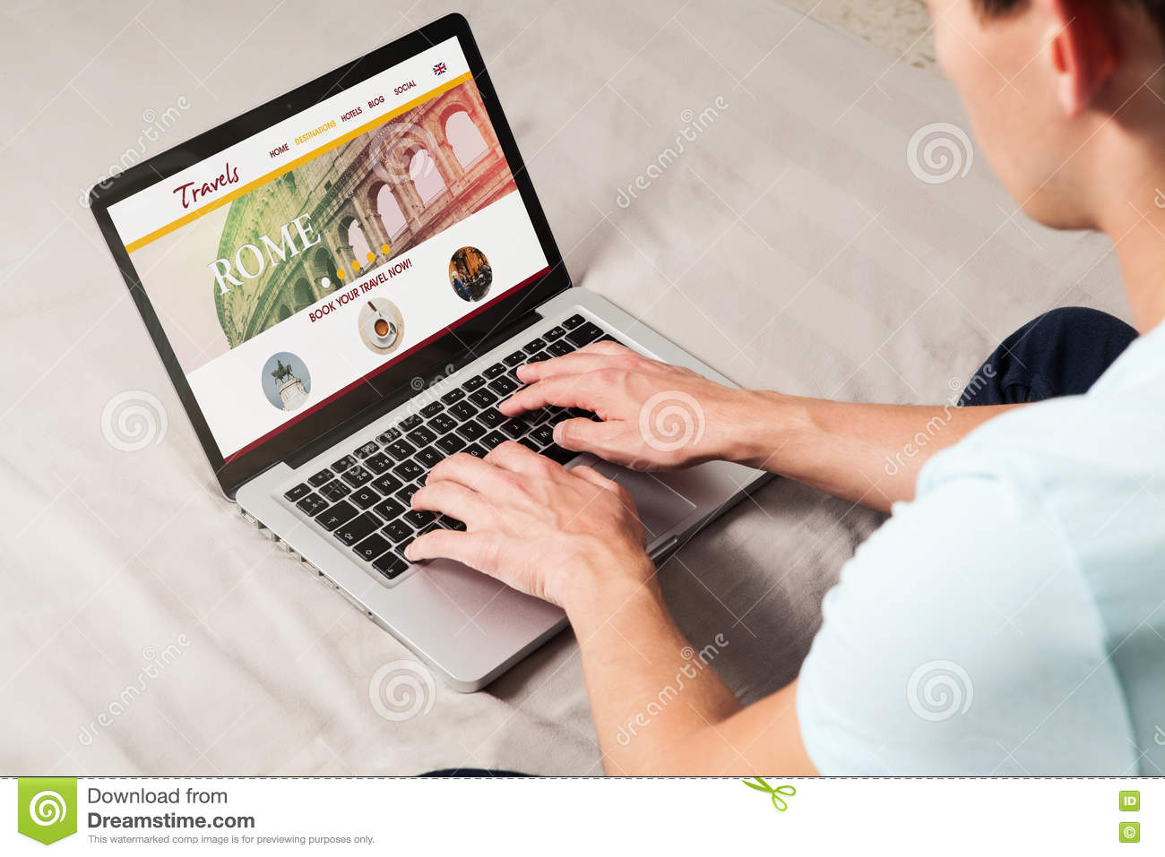 Traveling website in a laptop screen. Man using it to look for travel destination.