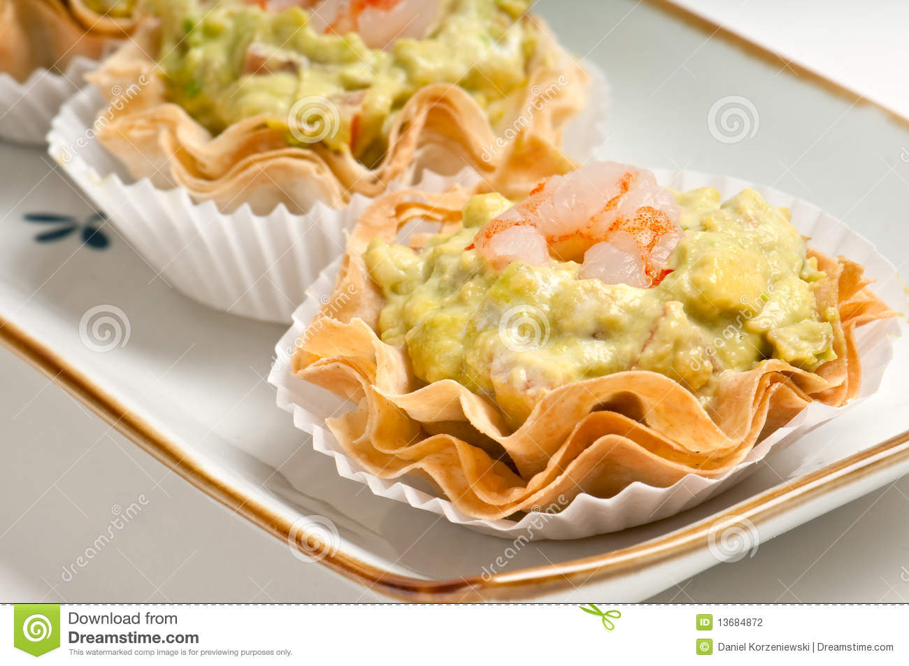 Tray of avocado and shrimp canape stock photography for What does canape mean in french