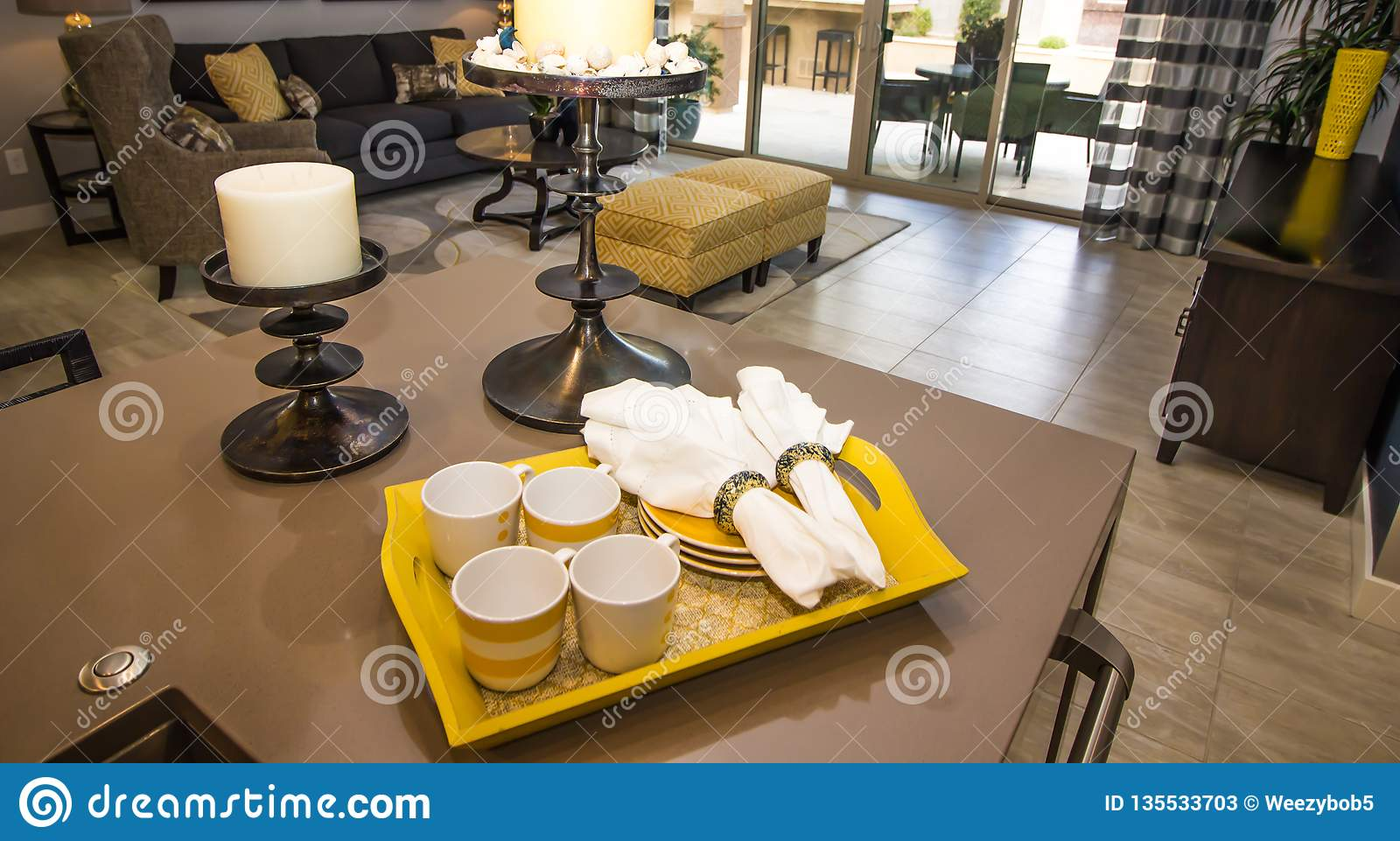 Tray Of Coffee Cups, Plates And Napkins On Kitchen Counter