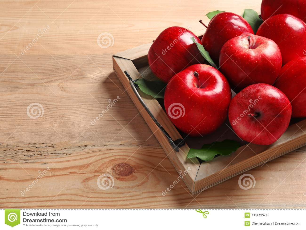 Tray with ripe red apples