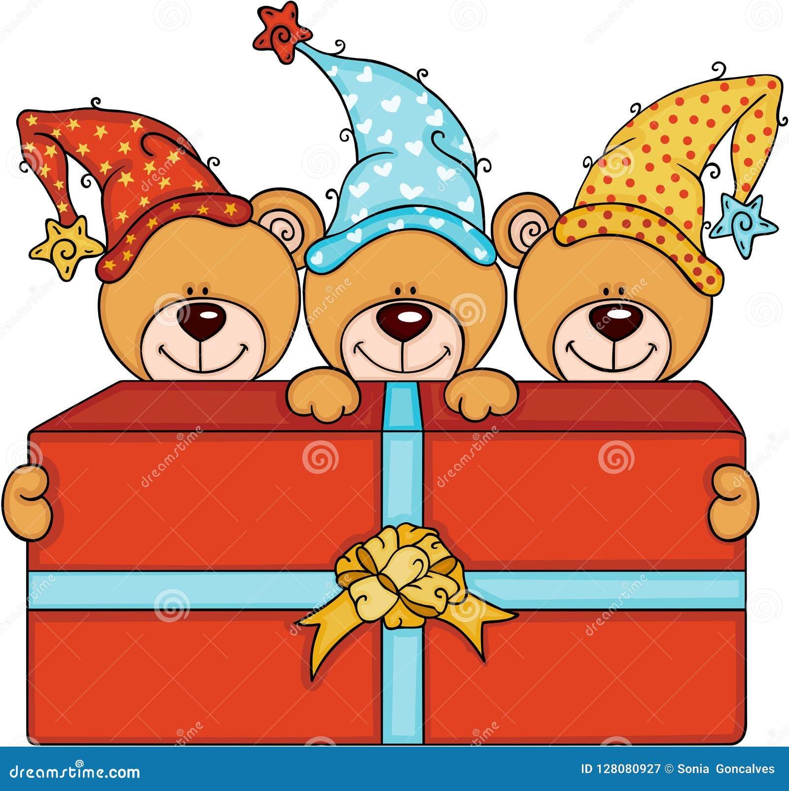Tre gulliga nallebjörnar med den stora röda gåvaasken