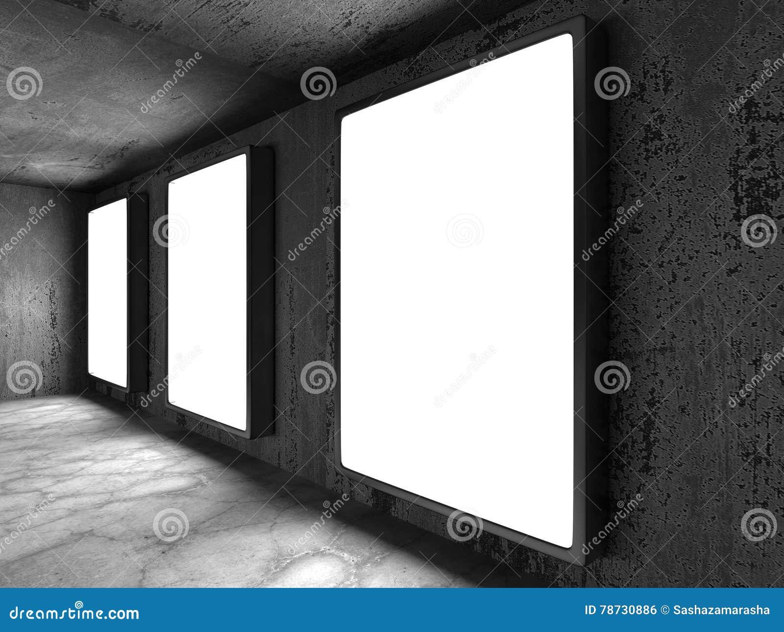 Tre ljusa softboxesbaner på den mörka rostiga väggen