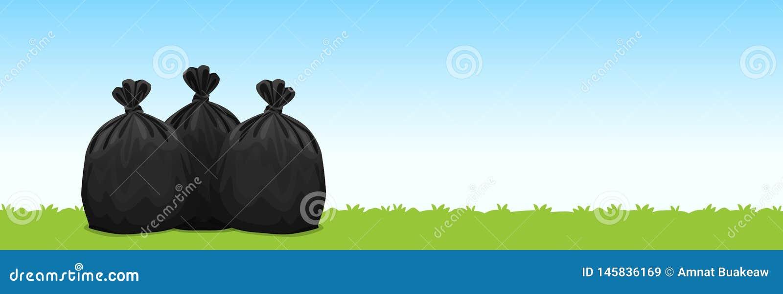 Tre svarta plast- avskr?dep?sar p? bakgrunden f?r bl? himmel f?r gr?s, avskr?dep?sar f?r avfalls, f?roreningplastp?seavfalls, ann