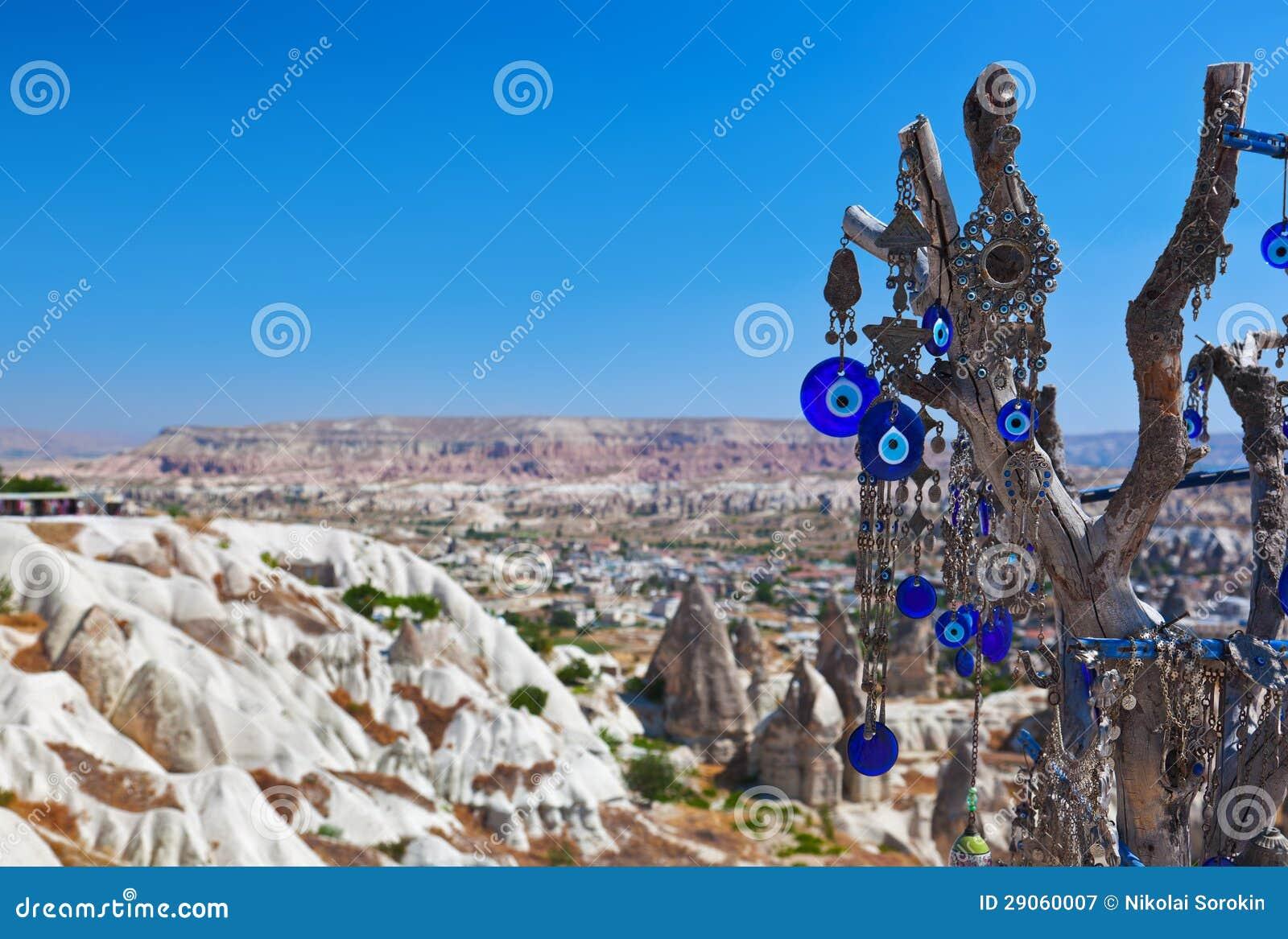 tree and evil eye amulet in cappadocia turkey stock image