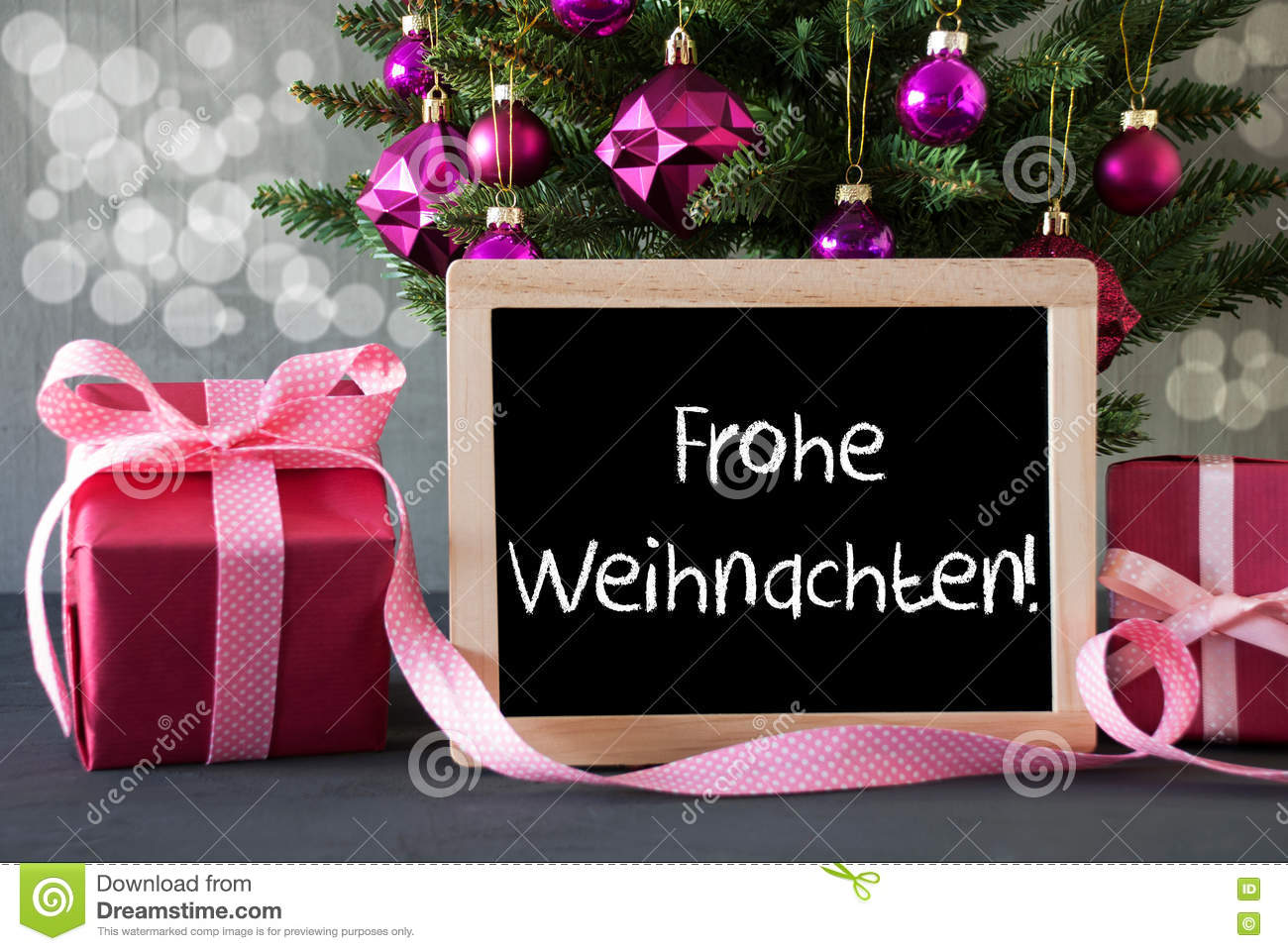 tree with gifts bokeh text frohe weihnachten means merry. Black Bedroom Furniture Sets. Home Design Ideas