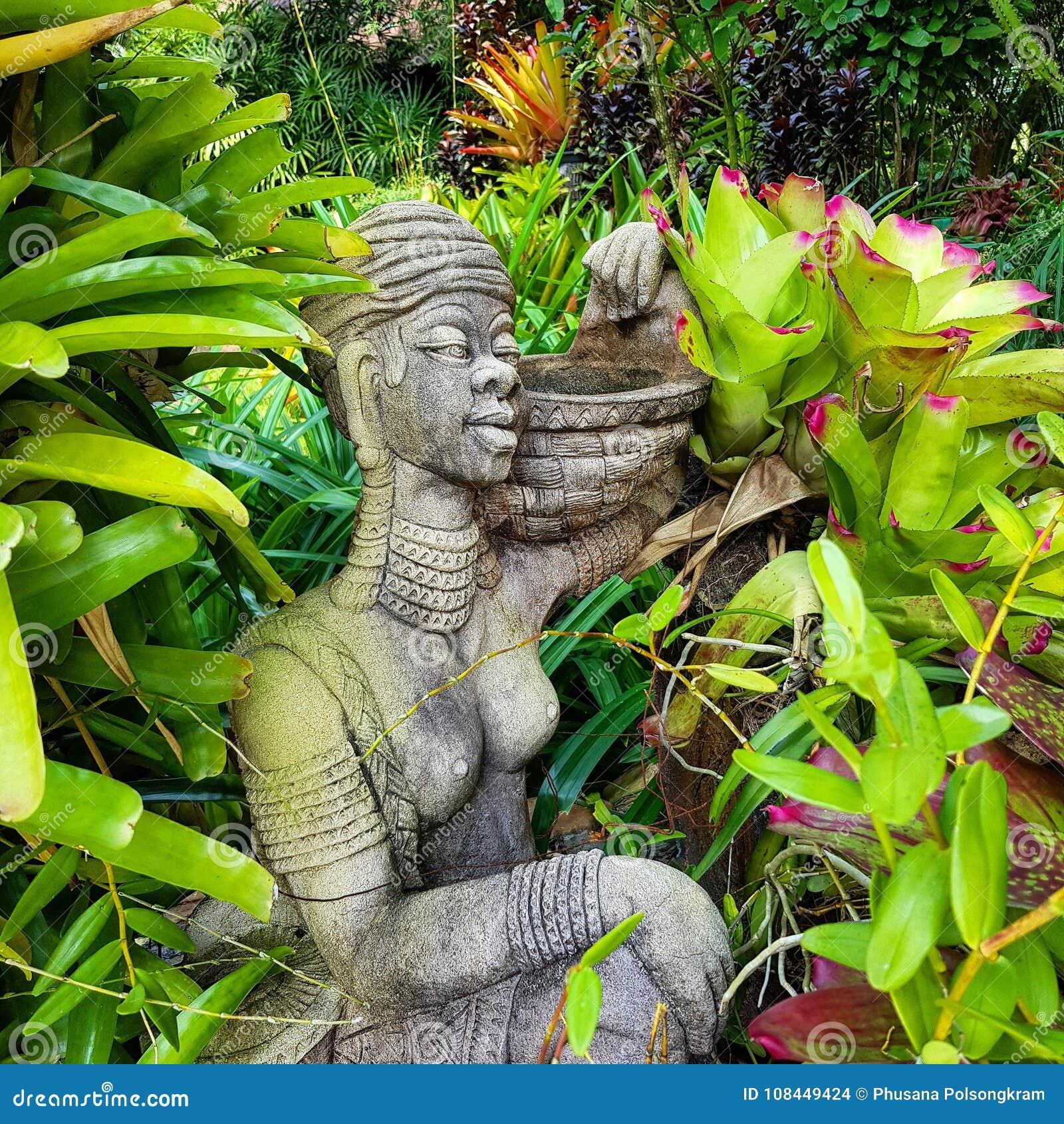 The Statue And Plants For Garden Arrangement