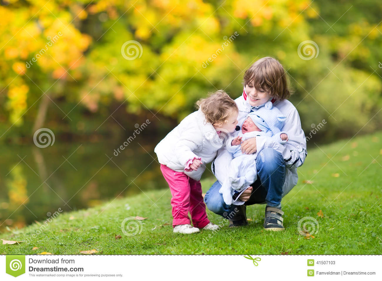 tree siblings on a walk in beautiful autumn park stock image