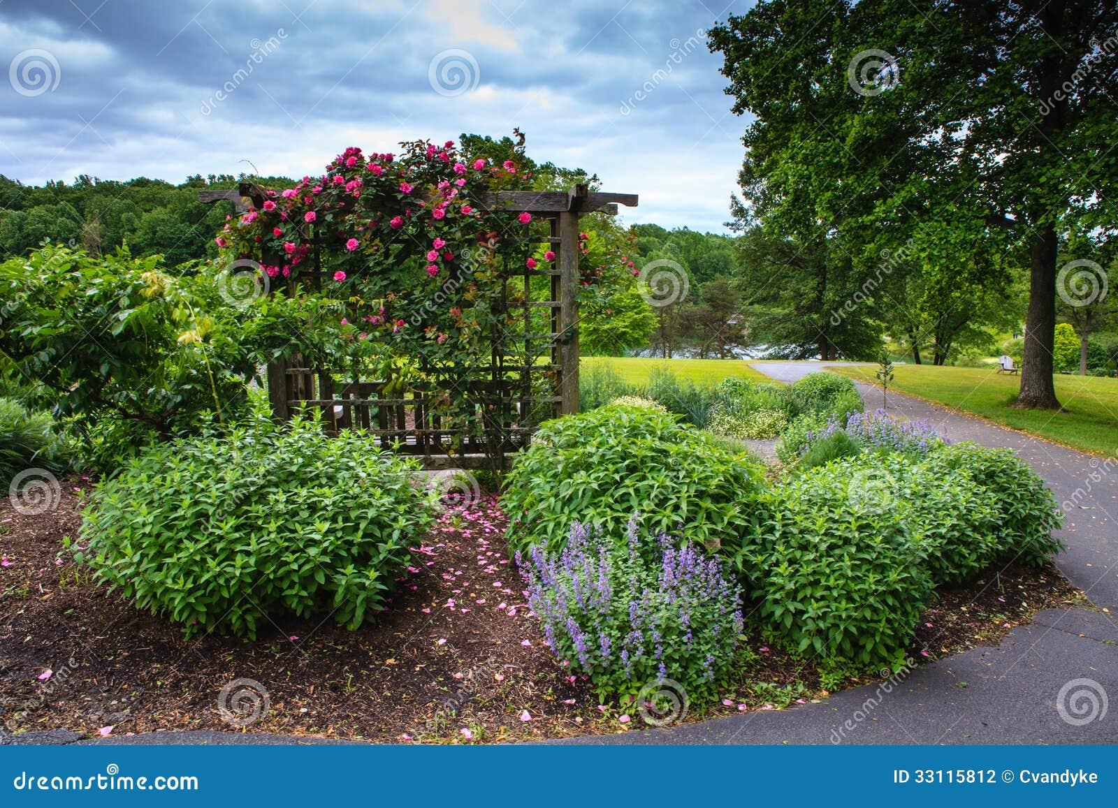trellis shelters a bench in a hillside garden in Virginia where ...