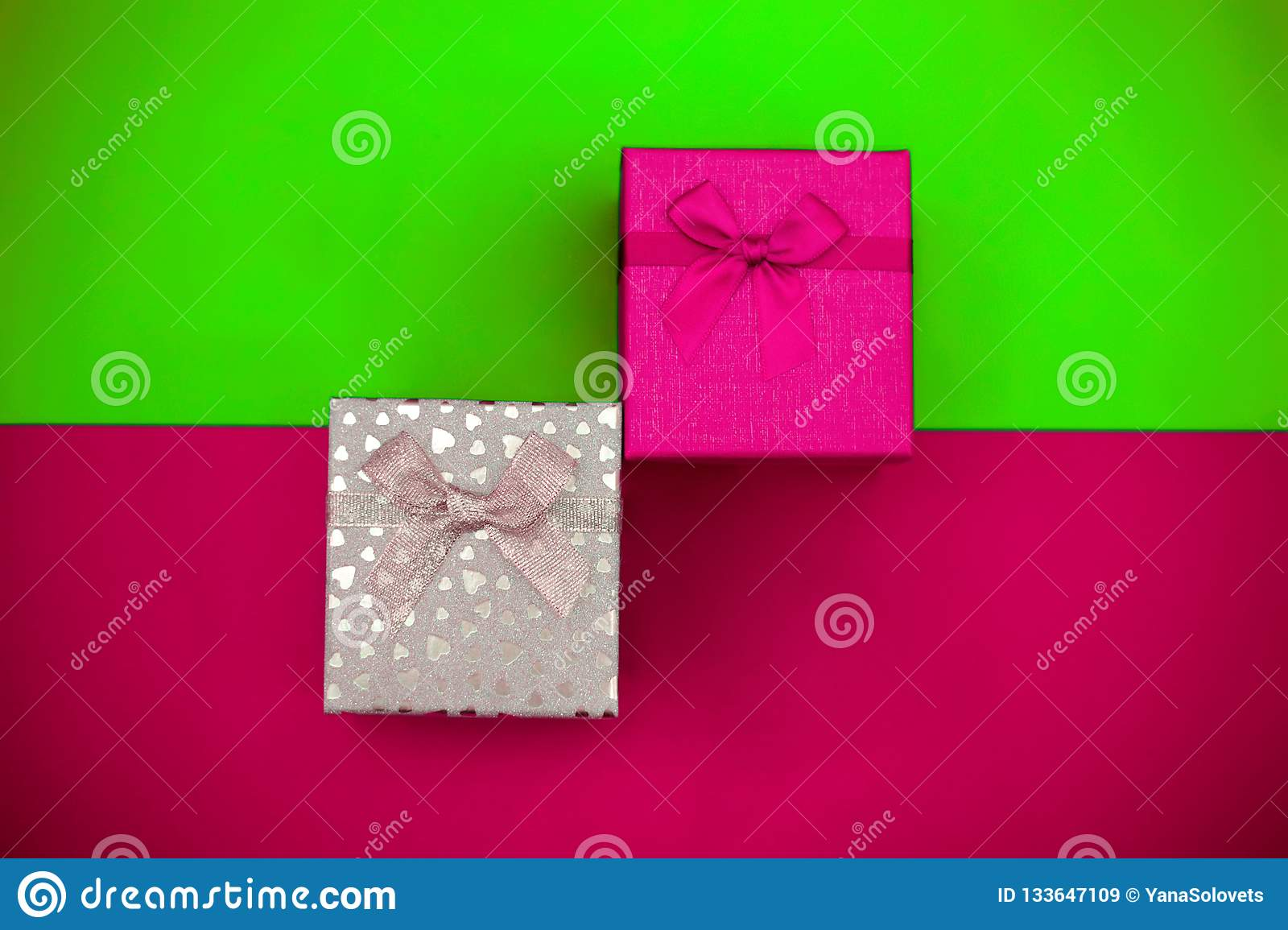 ae5618617991 Trend colorful holiday set. Plastic pink and UFO green gift boxes on the  multicolor background