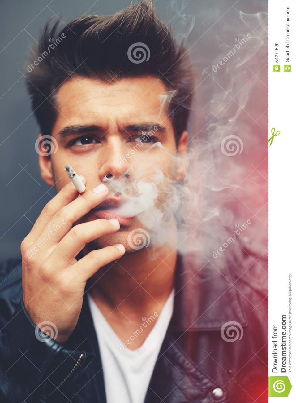 Trendy Attractive Man Blowing Smoke Out Of His Mouth