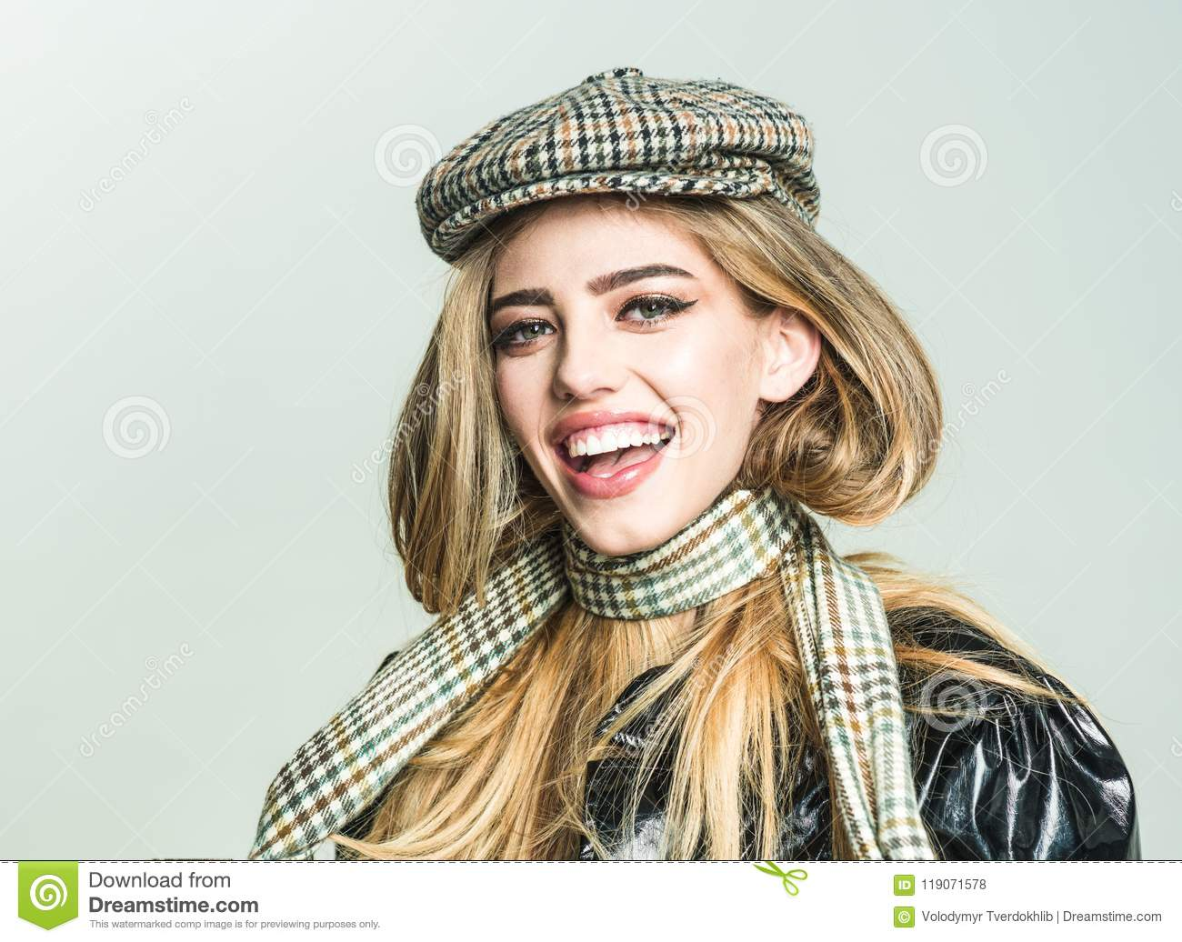 Trendy girl with makeup on sensual face. Autumn fashion for woman in hat and scarf. woman with stylish long hair in
