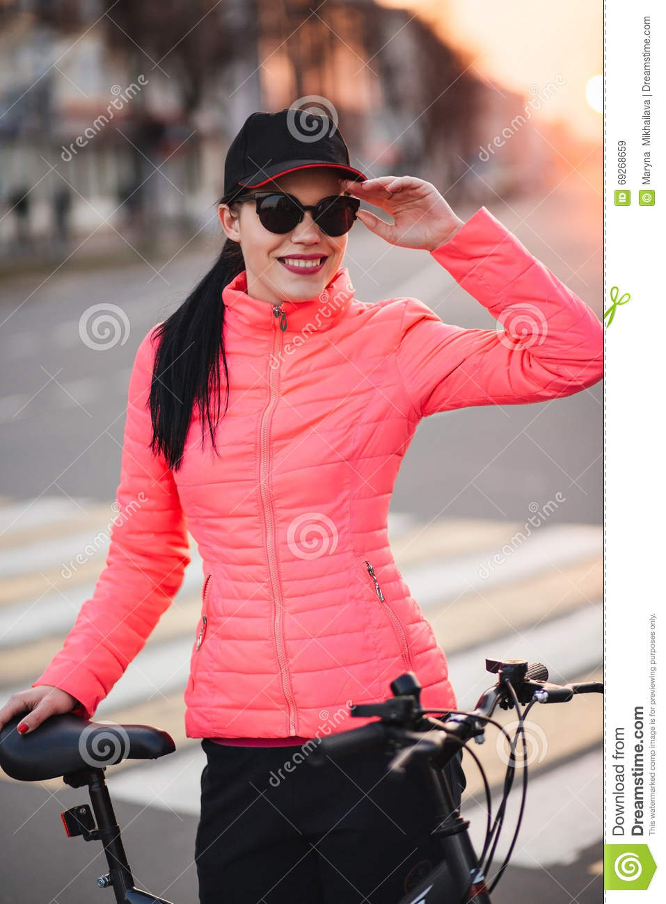 Trendy Hipster Girl with Bike on Urban Background. Toned and Filtered Photo. Modern Youth Lifestyle Concept. girl in a