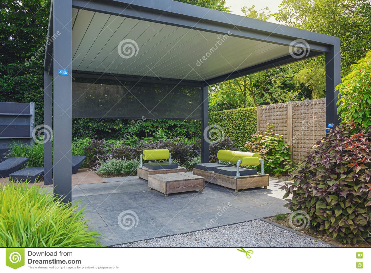 Trendy Sunloungers And Overhang With Trendy Garden