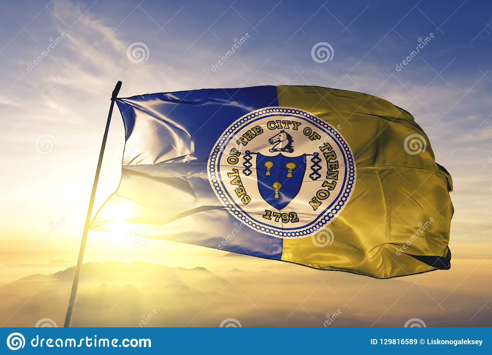 Trenton city capital of New Jersey of United States flag textile cloth fabric waving on the top sunrise mist fog