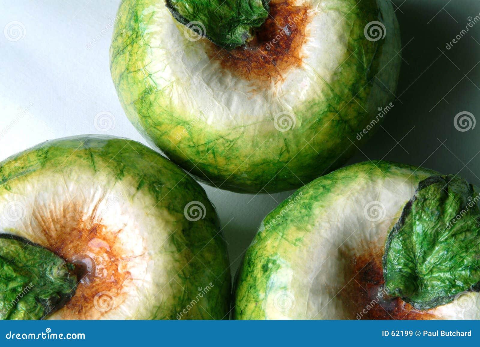 Tres manzanas del cartón piedra (macro)