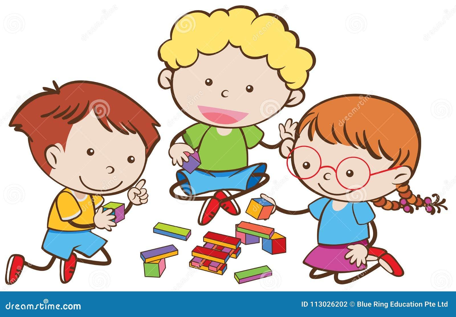 Tres niños que juegan bloques