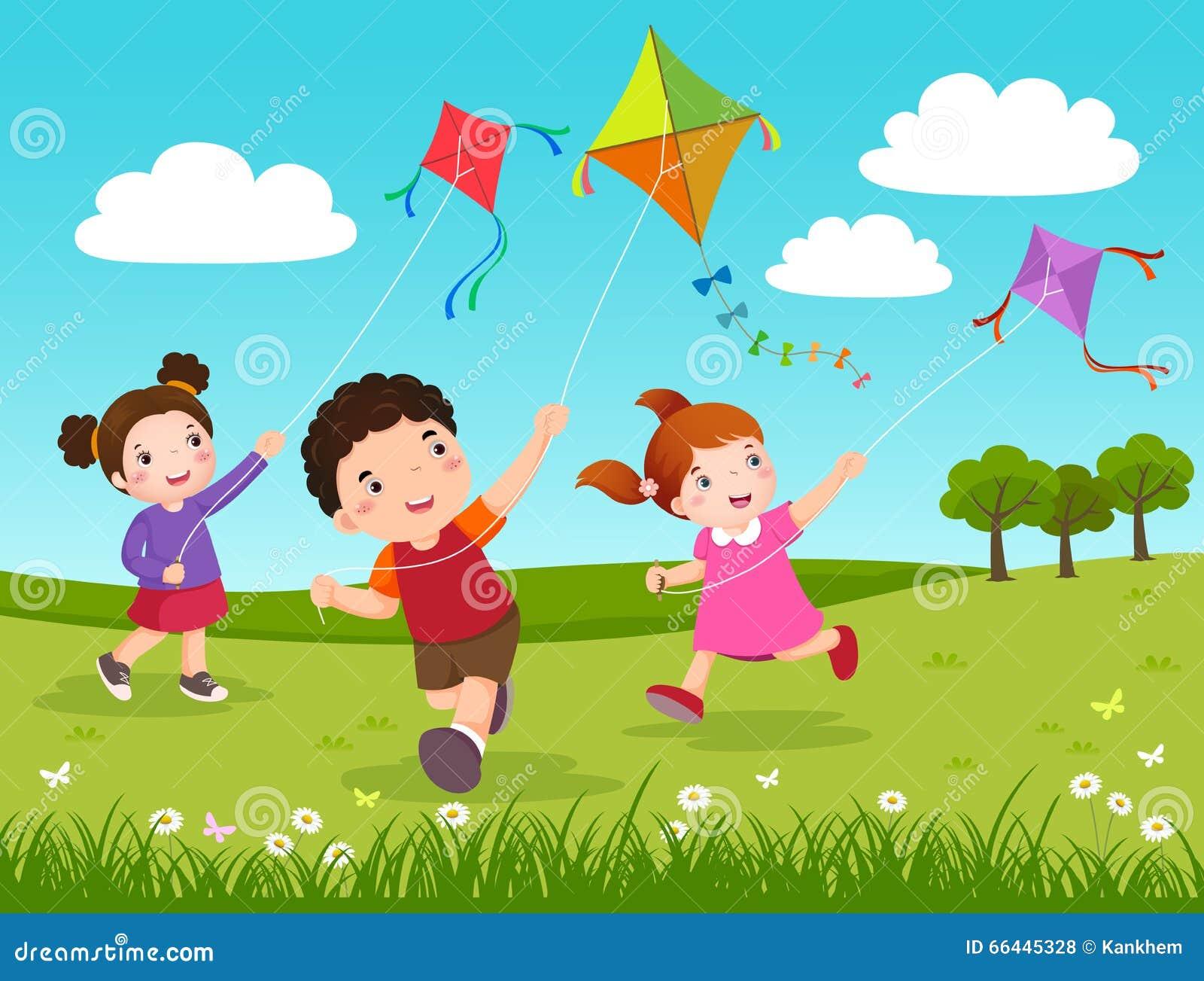 Tres niños que vuelan cometas en el parque