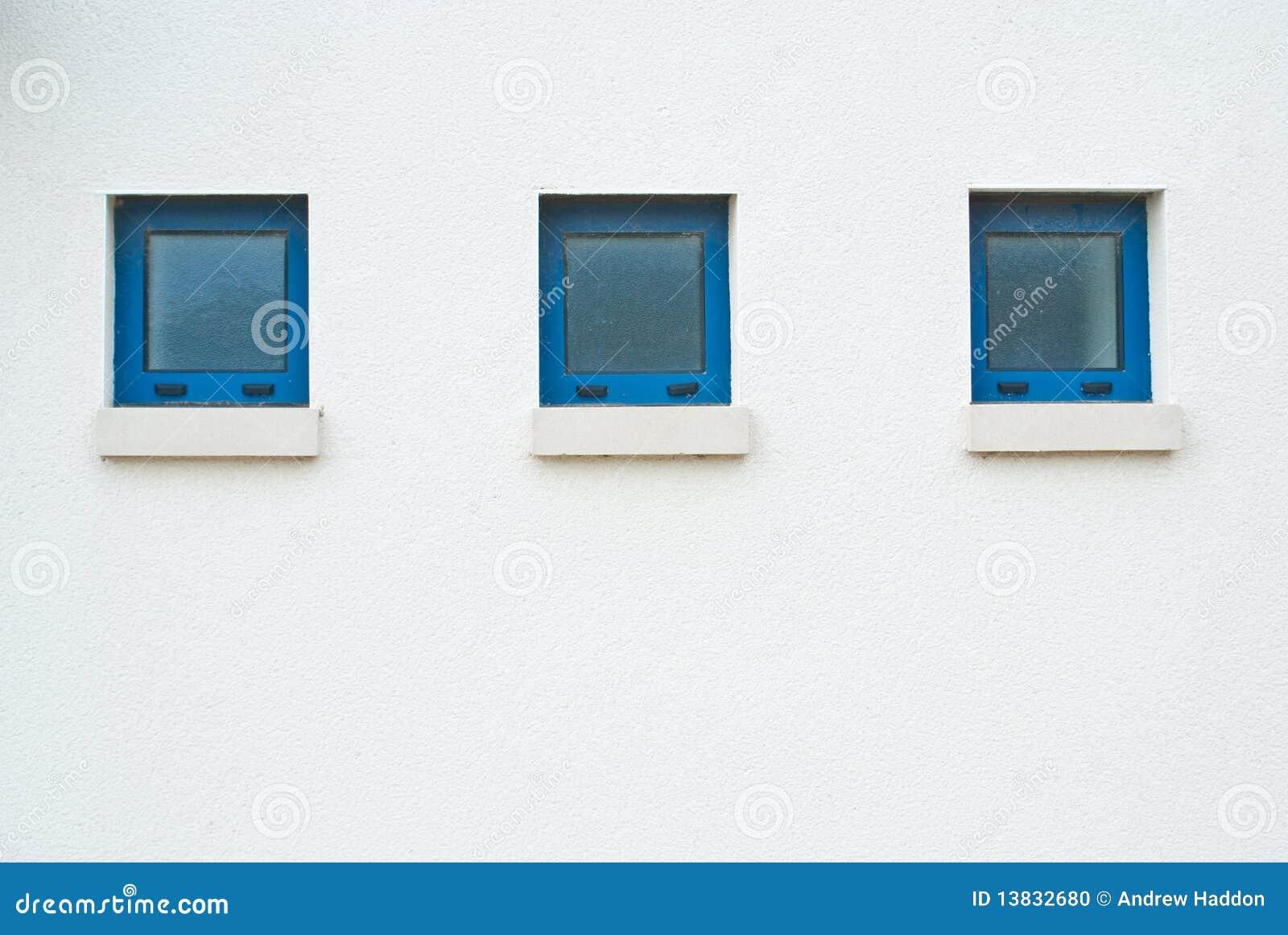 Tres Pequeñas Ventanas Azules Foto de archivo - Imagen de blanco ...