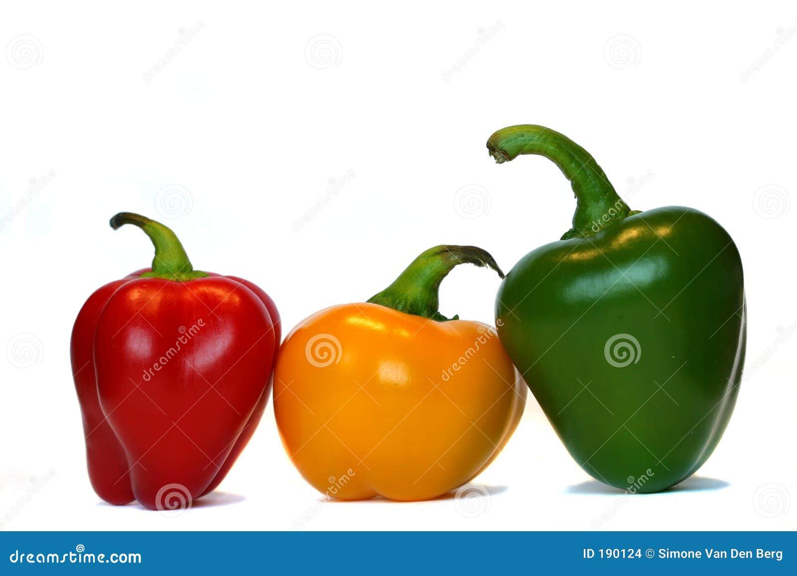 Tres pimientas en una fila