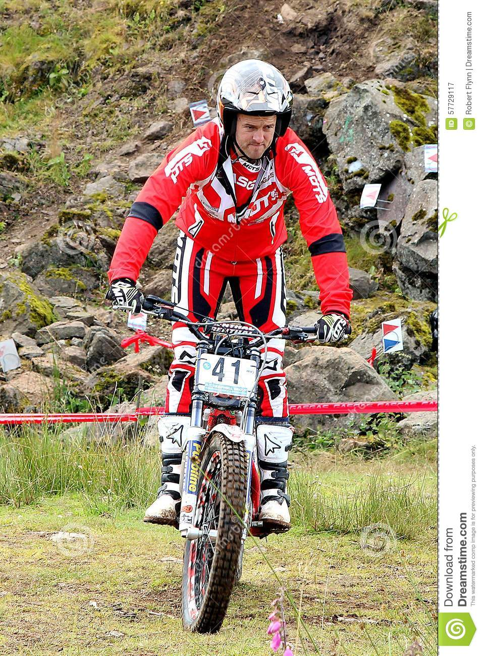 trial-motorcycle-rider-standing-bike-bri