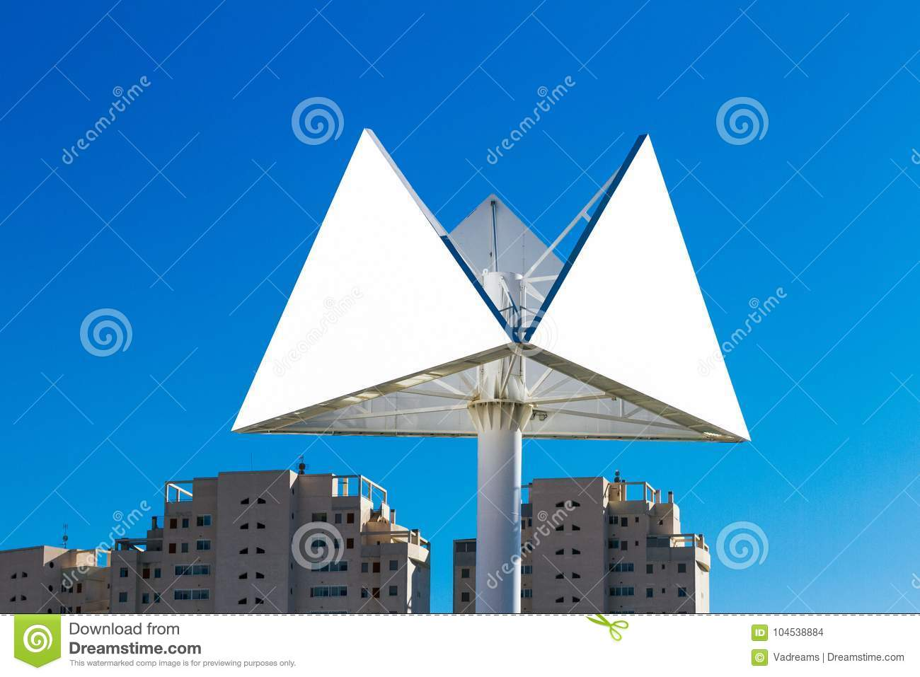 Triangle billboard or advertising poster with city and blue sky background