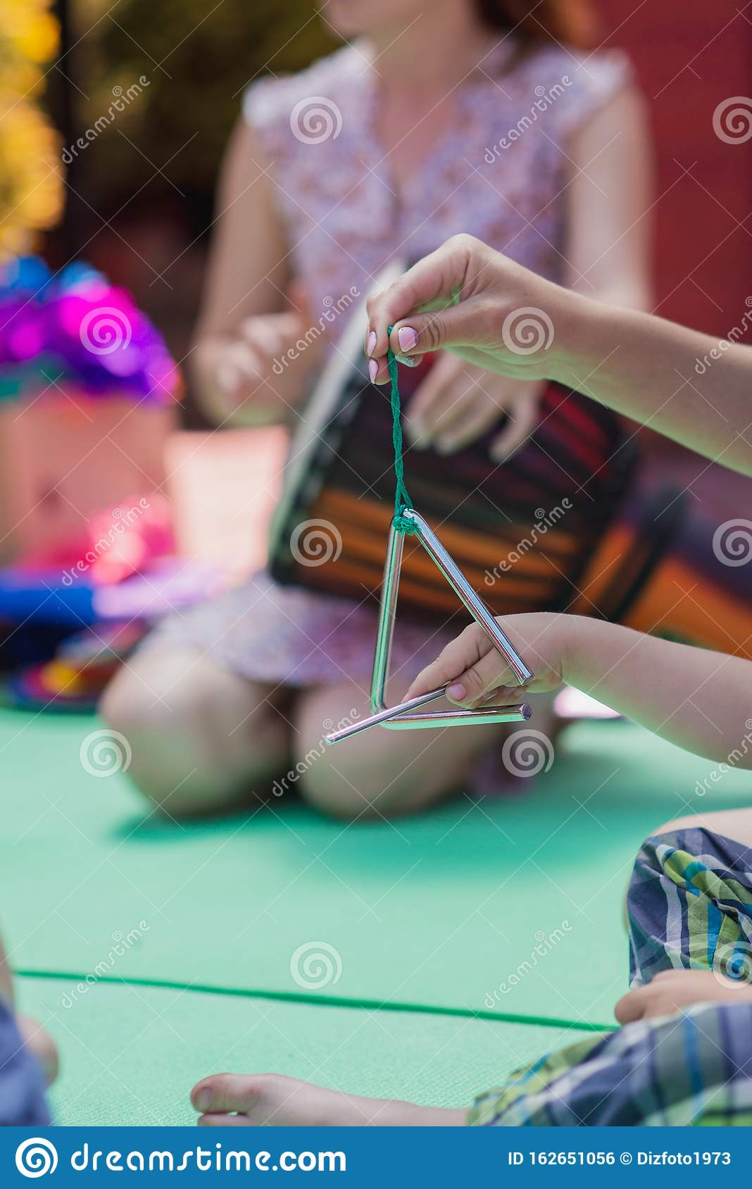 Triangle Percussion Musical Instrument. Music Lesson For Children Stock Photo - Image of child ...