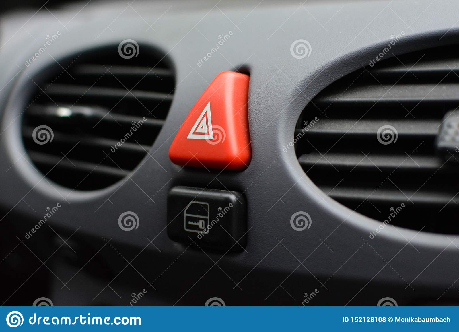 Triangular Red Hazard Flasher Button Inside Car Interior