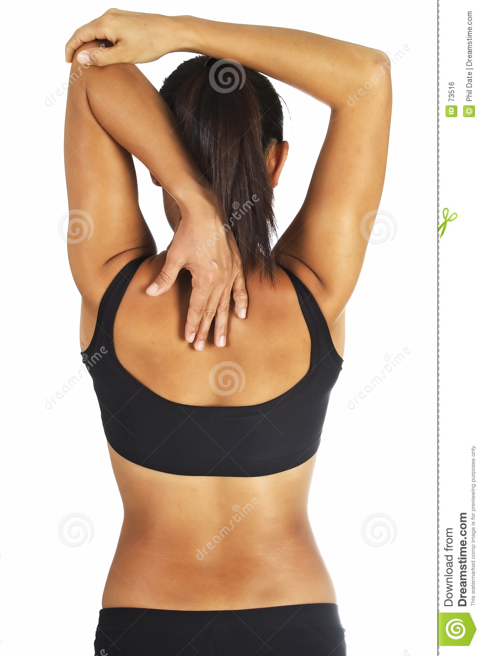female fitness instructor demonstrates a standing triceps stretch.