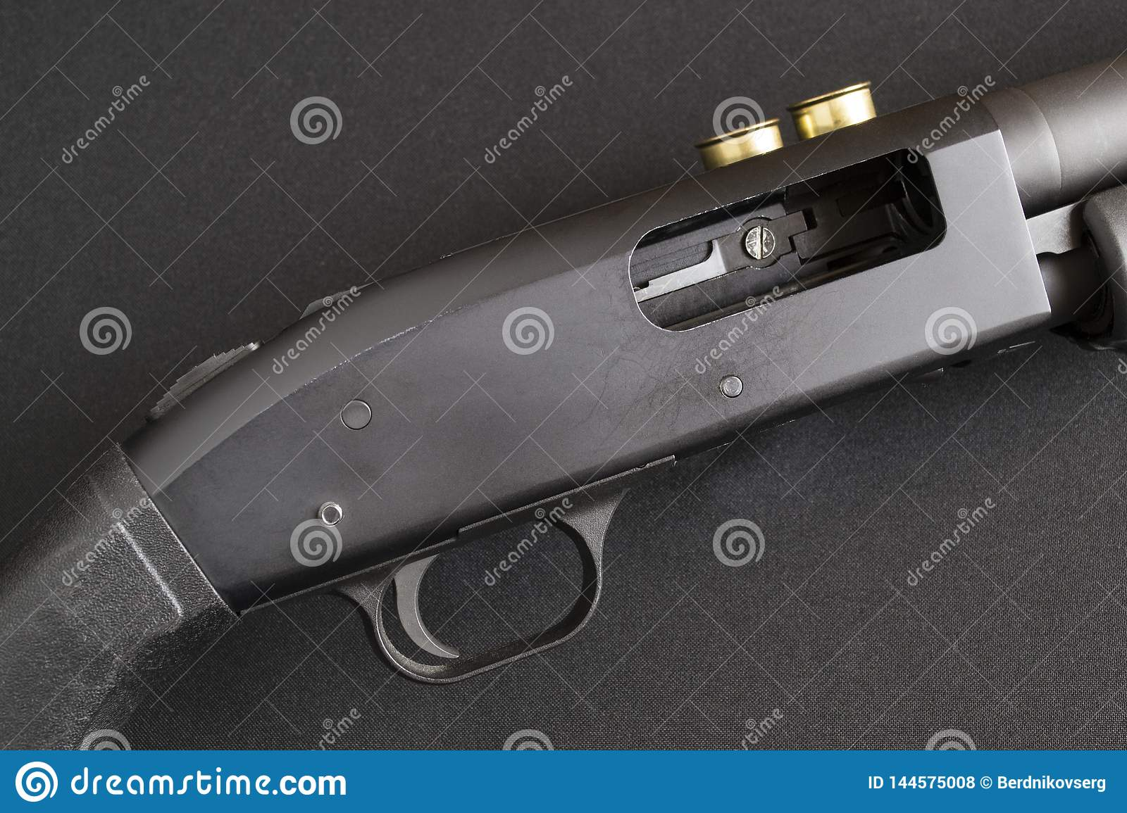 Trigger And Open Bolt Pump Action Shotgun  Stock Photo