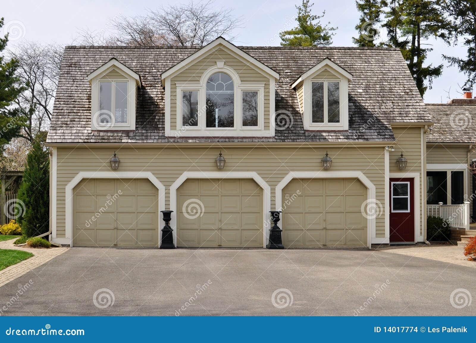 Triple garage stock photo image of garage doors luxury for Garage designer online free