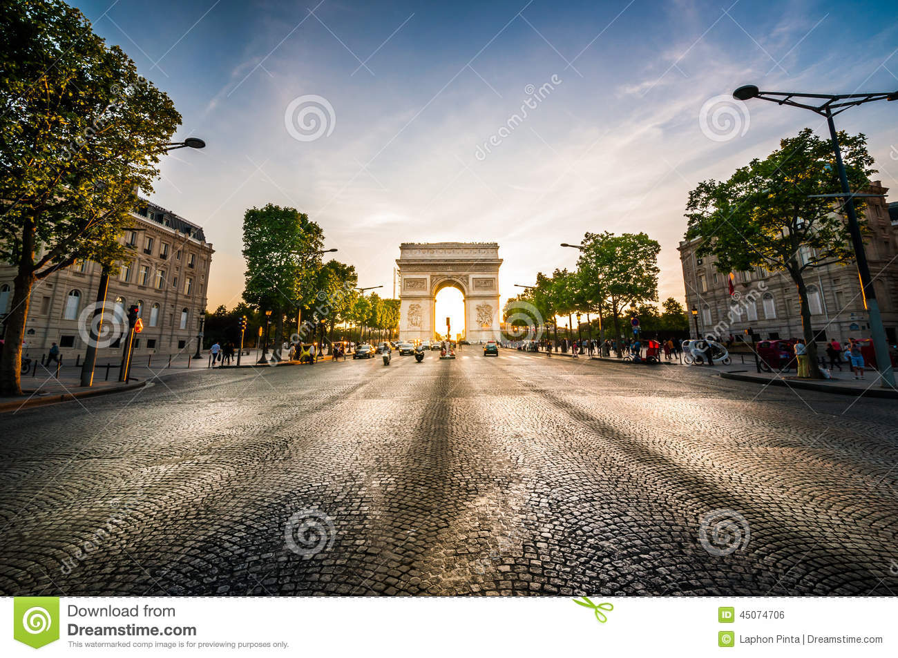 Triumphal Arch at the end of Champs-Elysees street before sunset