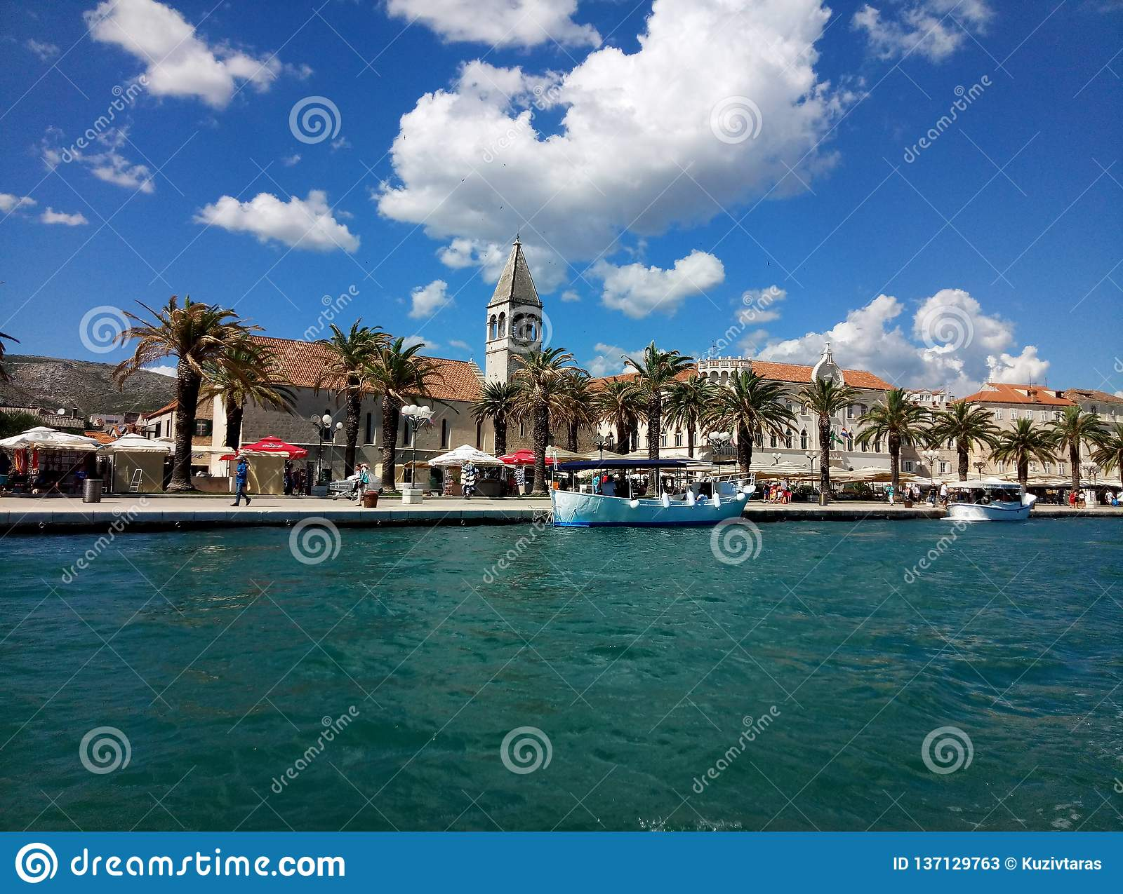 Trogir / Croatia - June 26 2017: A waterfront view on the marine promenade of Trogir from the sightseeing boat